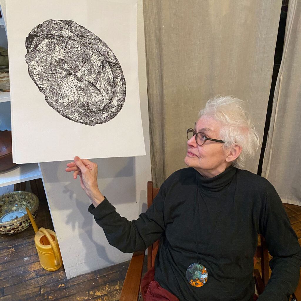 Alison Knowles shows the mesh of The House of Dust