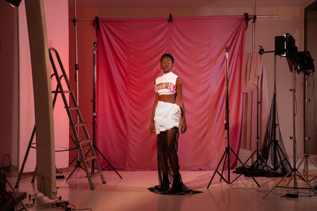 Model wears 3d printed clothing line TECHNE
